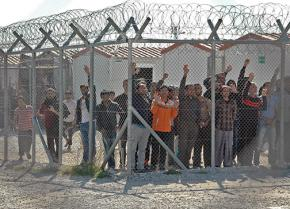 Immigrant prisoners at the Amygdaleza Detention Center greet a protest march calling for the center to be closed