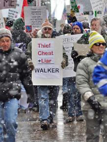 Wisconsin workers march against Gov. Scott Walker's union-busting and budget cuts