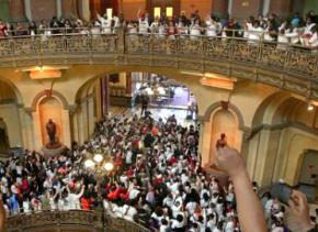 Protesters pack the Illinois Capitol building to protest Gov. Bruce Rauner's budget cuts