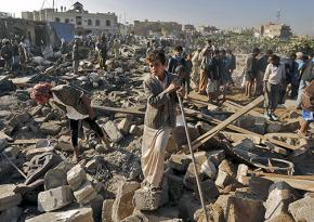 Searching through the rubble left behind after a Saudi air strike in Yemen