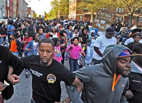 Protesters in the streets of Baltimore to demand justice for Freddie Gray