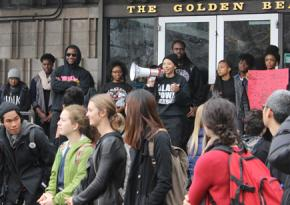 Members of the UC Berkeley Black Student Union outside the cafeteria occupation, with supporters in front