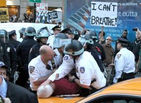 New York police piling on a protester at a march in solidarity with Baltimore's uprising
