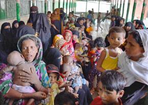 Rohingya refugees wait for medical care in Bangladesh