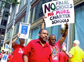 Chicago teachers picket the Board of Education to protest its manufactured budget crisis