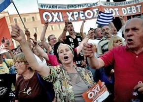 "Athens residents celebrate the ""no"" vote against austerity in front of Greece's parliament"