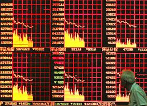 Indicators of China's stock market on a Shanghai street