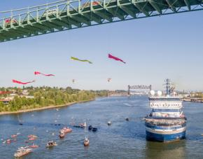 Environmental activists repel off of the St. John's Bridge in Portland, Oregon