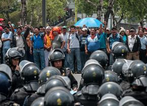 Oaxaca teachers organized in the CNTE face off with police at a mass march