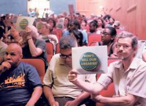 Opponents of the plan to sell the Brooklyn Heights Library protest at a meeting of Brooklyn Community Board 2