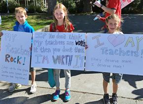 Students join their teachers on the picket line to show support
