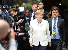 German Chancellor Angela Merkel surrounded by the media