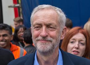 Jeremy Corbyn arrives at a refugee rights rally after his victory in the Labour Party leadership vote