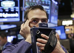 A worried trader on the floor of the New York Stock Exchange