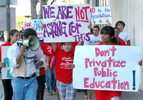 Teachers, students and community members in Los Angeles protest a decision to put 250 schools up for bidding