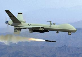 A Predator drone fires its weapons
