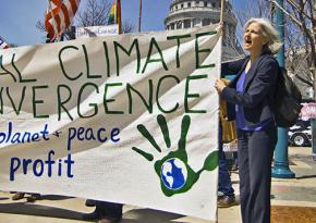 Dr. Jill Stein (right) marching for climate and economic justice in New York