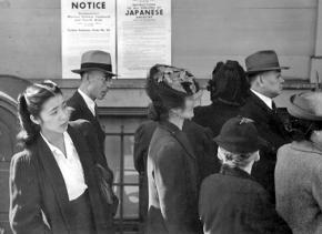 Japanese Americans lined up to register for transfer to the camps