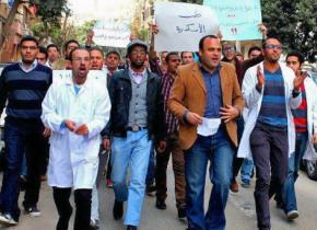 Dr. Taher Mokhtar (second from right, in brown jacket) leads a demonstration during the January 2014 doctor's strike