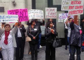 Midtown residents and their supporters gather for a rent control rally
