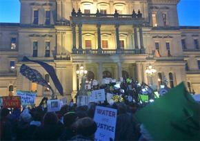 Hundreds demonstrated outside the Michigan state Capitol building as the governor was speaking