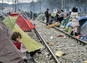 Refugee families stranded in a camp in Greece