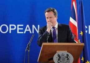 British Prime Minister David Cameron speaks to reporters during a European Council meeting