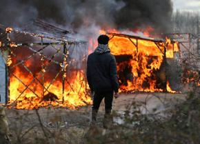 The refugee camp in Calais goes up in flames