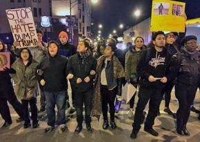Protesters link arms outside of the Chicago Trump rally