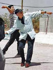 The late Edward Said casts a symbolic stone of resistance toward Israel from Lebanon