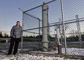 Michael Hickey stands next to the polluted municipal well in Hoosick Falls, New York