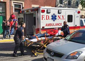 A Verizon striker, injured by a New York City police officer driving a scab truck, is taken to the hospital