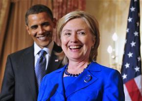 Hillary Clinton speaks as Barack Obama looks on