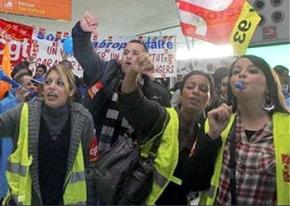 Striking French rail workers demonstrate inside a terminal