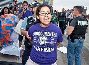 Nadia Sol Ireri Unzueta Carrasco is detained during a civil disobedience action