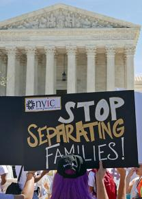 Immigrant rights activists gather in front of the U.S. Supreme Court