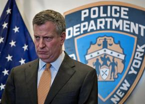 New York City Mayor Bill de Blasio speaks to reporters