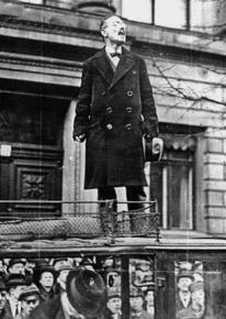 Germany revolutionary Karl Liebknecht speaks to a crowd from on top of a car
