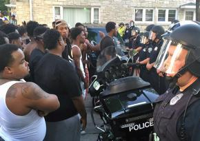 Protesters confront police following the murder of Sylville Smith