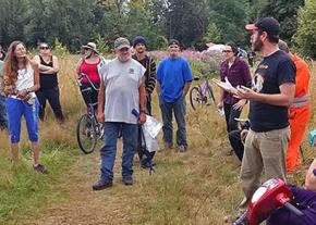 Supporters of the homeless residents of a camp gather in Portland