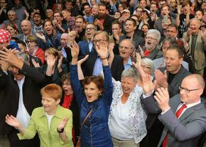 Die Linke representatives and supporters celebrate election results in Berlin