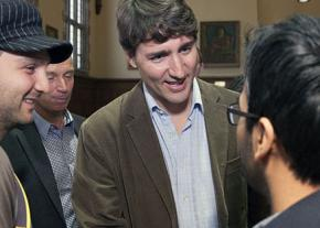 Canadian Prime Minister Justin Trudeau (center) speaks with students in Ontario