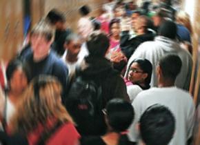 High school students crowd into a hallway between classes