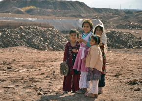 Refugee children gathered outside the war zone