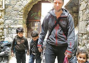 Palestinian rights activist Christoph Glanz (center)