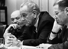 President Lyndon Johnson (center) with Defense Secretary Robert McNamara (right)