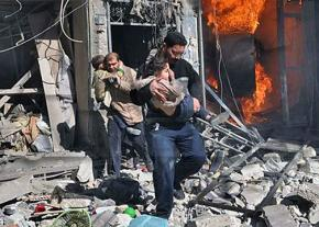 Residents of Aleppo rescue children from a burning house after another air strike