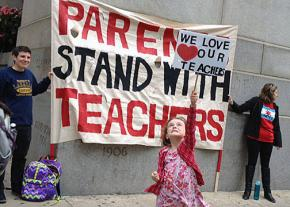 Parents and students show their support for Chicago's teachers outside City Hall