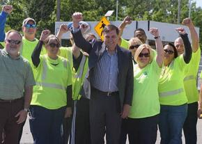 Rank-and-file Teamsters stand with reform presidential candidate Fred Zuckerman (center)