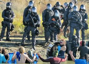 Police crack down on peaceful water protectors with rubber bullets and pepper spray